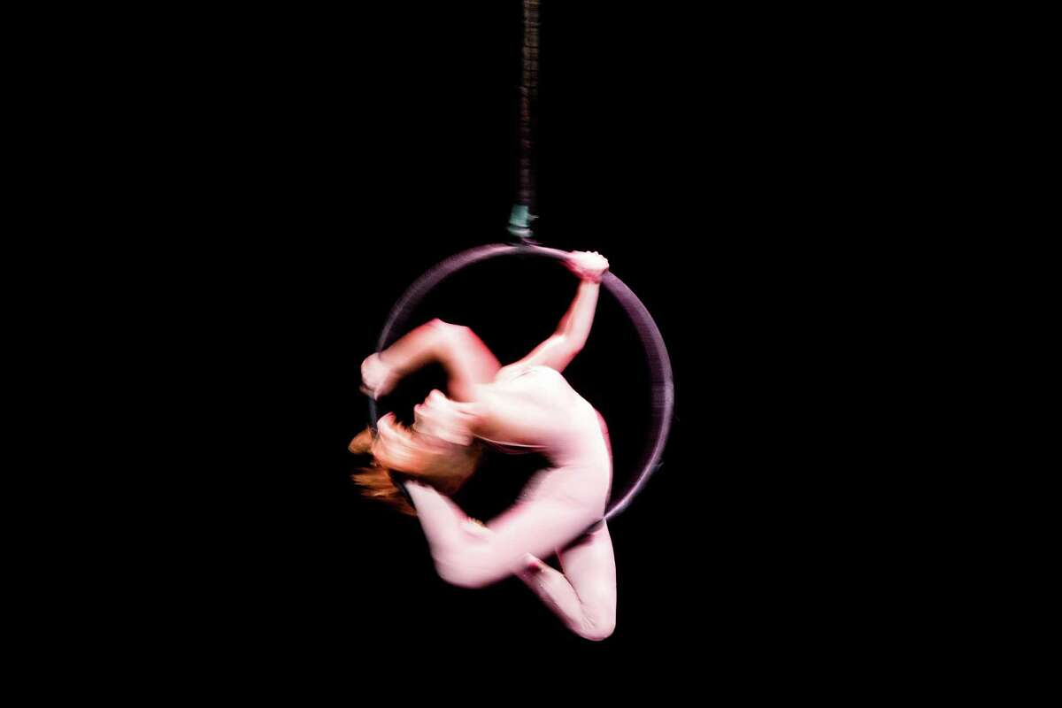 Rebecca Palmer spins on a lyra during the professionals class of the 2016 U.S. National Pole Championships at the Kirkland Performance Center on Saturday, Aug. 13, 2016.