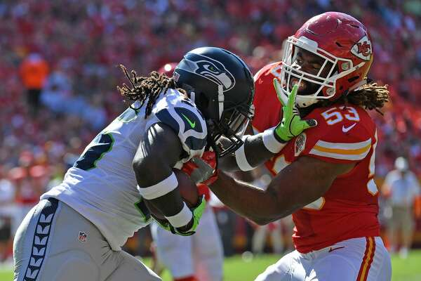 KANSAS CITY, MO - AUGUST 13:  Line backer Ramik Wilson #53 of the Kansas City Chiefs tackles running back Alex Collins #36 of the Seattle Seahawks during the first half on August 13, 2016 at Arrowhead Stadium in Kansas City, Missouri.  (Photo by Peter Aiken/Getty Images)