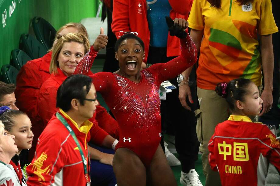 RIO DE JANEIRO, BRAZIL - AUGUST 14:  Simone Biles of the United States celebrates winning the gold medal in the Women's Vault Final on Day 9 of the Rio 2016 Olympic Games at the Rio Olympic Arena on August 14, 2016 in Rio de Janeiro, Brazil.  (Photo by Patrick Smith/Getty Images) Photo: Patrick Smith/Getty Images