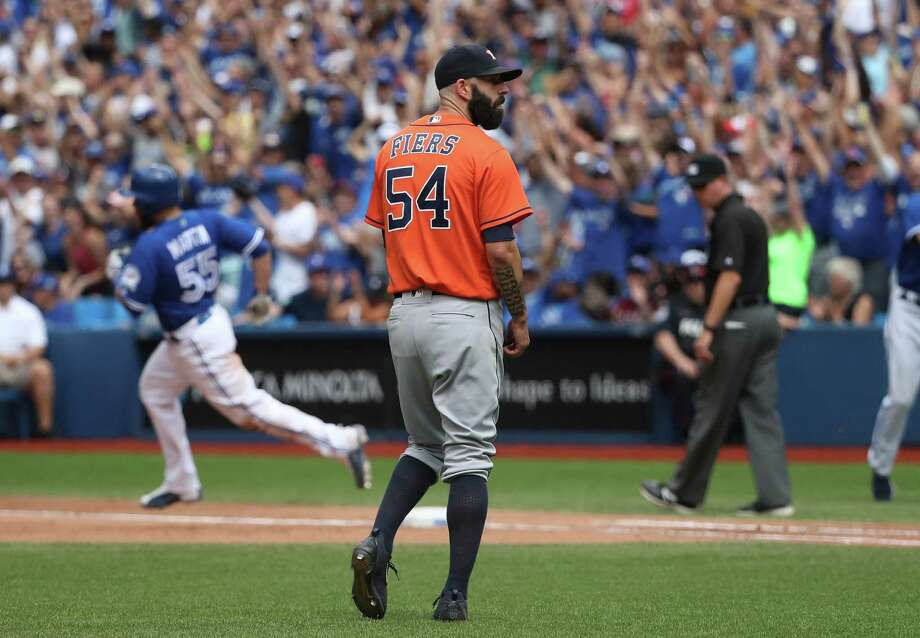 TORONTO, CANADA - AUGUST 14: Mike Fiers #54 of the Houston Astros reacts after giving up a solo home run to Russell Martin #55 of the Toronto Blue Jays in the fifth inning during MLB game action on August 14, 2016 at Rogers Centre in Toronto, Ontario, Canada. Photo: Tom Szczerbowski, Getty Images / 2016 Getty Images