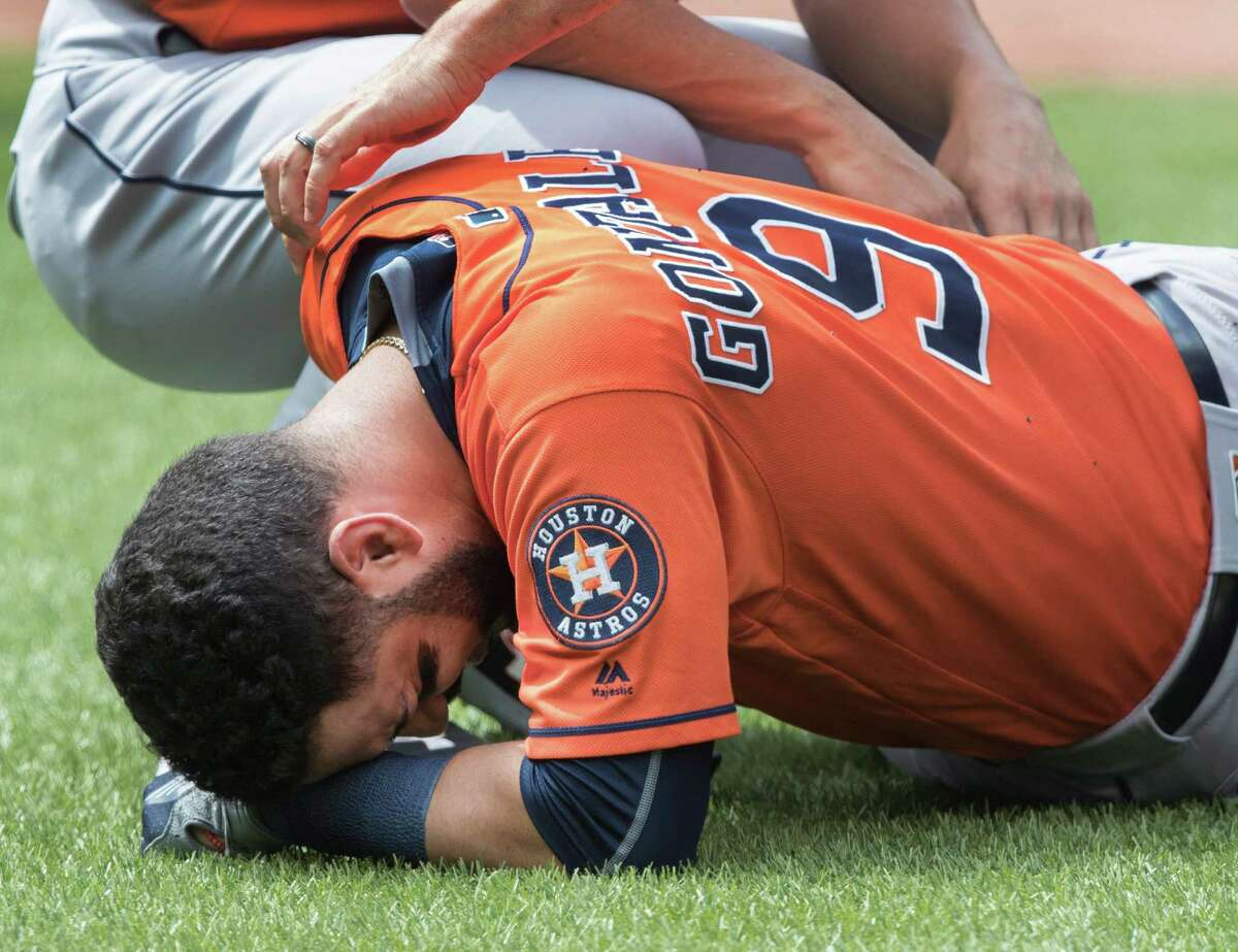 Houston Astros' Marwin Gonzalez lies on the ground after being hit by a Toronto Blue Jays pitch during the second inning of a baseball game Sunday, Aug. 14, 2016, in Toronto. (Fred Thornhill/The Canadian Press via AP)
