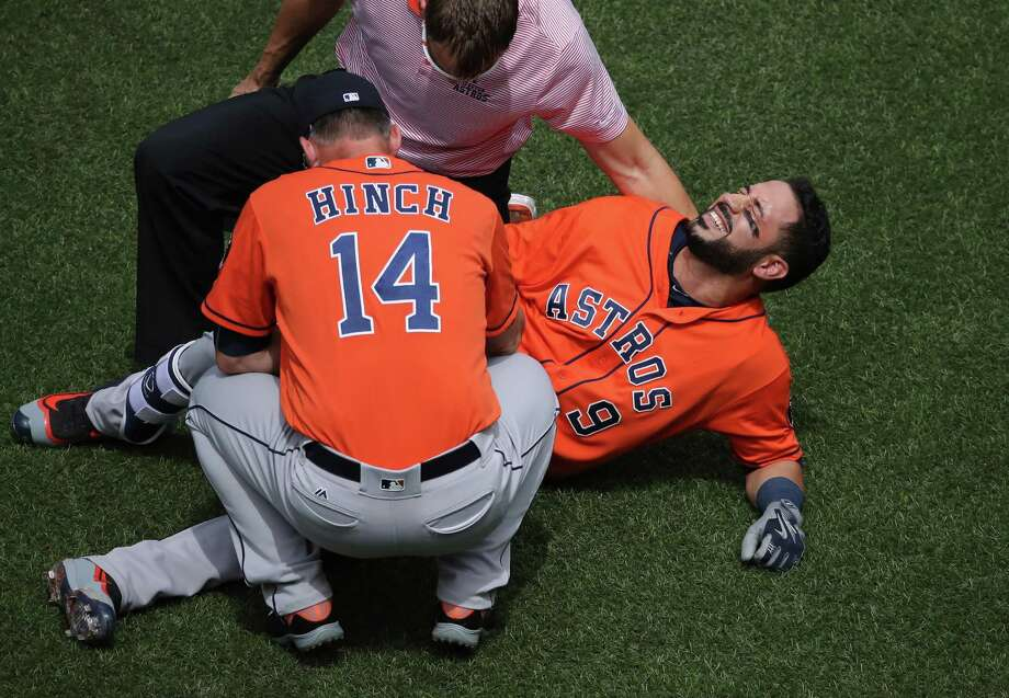 TORONTO, CANADA - AUGUST 14: Marwin Gonzalez #9 of the Houston Astros reacts after being hit by pitch as manager A.J. Hinch #14 and the trainer tend to him in the first inning during MLB game action against the Toronto Blue Jays on August 14, 2016 at Rogers Centre in Toronto, Ontario, Canada. Photo: Tom Szczerbowski, Getty Images / 2016 Getty Images