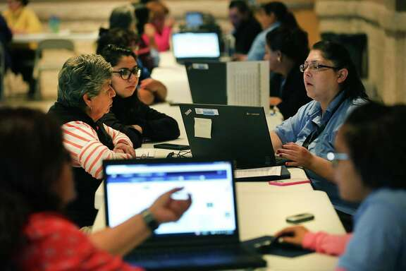 Assistors (right) help individuals enrolling in the 2016 health insurance plans through the Affordable Care Act in San Antonio. Cost-sharing payments are the less well-known part of the financial help that the Affordable Care Act provides, but the support is baked into the plans bought by more than half of the 12.2 million people insured through the exchanges. The payments — estimated to add up to $7 billion this year by the Congressional Budget Office — allow lower-income people to buy plans with smaller deductibles and co-pays.
