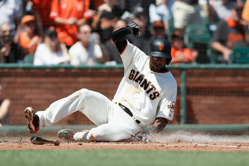 SAN FRANCISCO, CA - AUGUST 14: Eduardo Nunez #10 of the San Francisco Giants crosses home plate to score on a single hit by Trevor Brown #14 of the San Francisco Giants in the second inning against the Baltimore Orioles during an interleague game at AT&T Park on August 14, 2016 in San Francisco, California. (Photo by Lachlan Cunningham/Getty Images)