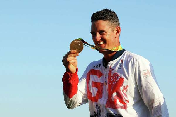RIO DE JANEIRO, BRAZIL - AUGUST 14:  Justin Rose of Great Britain celebrates with the gold medal after winning in the final round of men's golf on Day 9 of the Rio 2016 Olympic Games at the Olympic Golf Course on August 14, 2016 in Rio de Janeiro, Brazil.