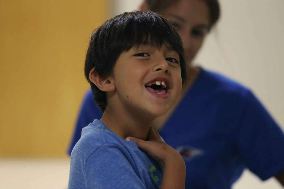 Gael Gonzalez, 6, reacts during an exercise to improve his communications and social skills at an autism clinic at the Children's Hospital of San Antonio. The Legislature has the opportunity to make applied behavior analysis accessible to more Texas families. Photo: Jerry Lara /San Antonio Express-News / © 2016 San Antonio Express-News