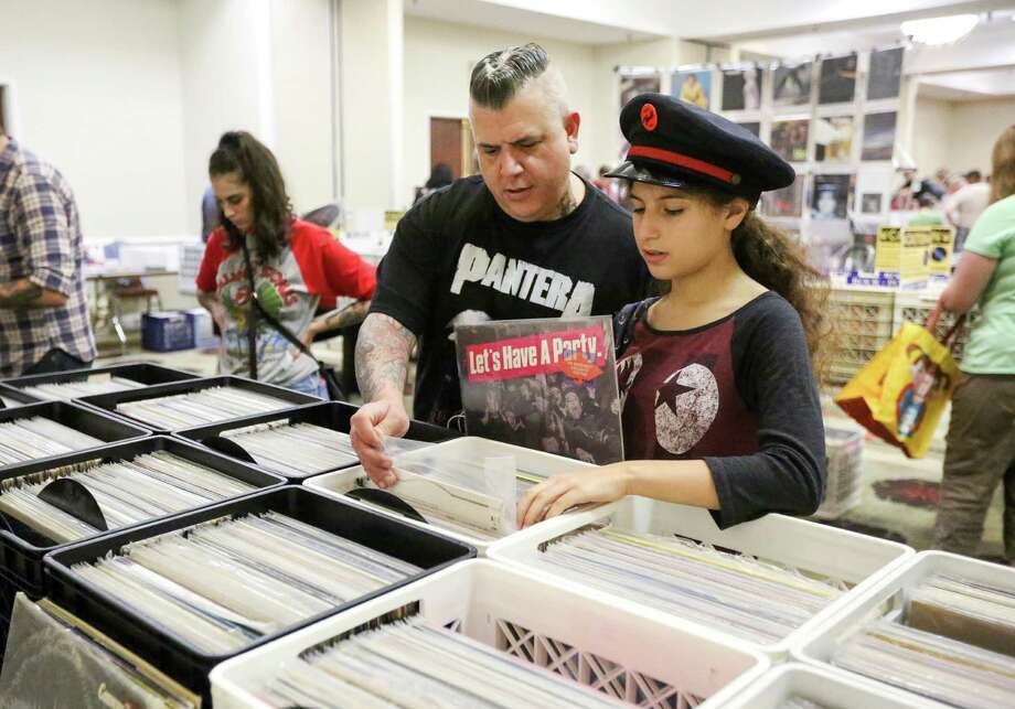 Julia DeLise, 13, shops with her father, John, at the Houston Record Convention on Sunday. John DeLise, who had collected records since he was a child, credited his daughter with rekindling his interest after his collection was stolen.  Photo: Jon Shapley, Staff / © 2015  Houston Chronicle