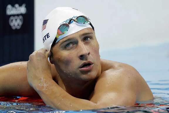 Olympic gold medalist Ryan Lochte said a cocked gun was put to his head during the robbery.