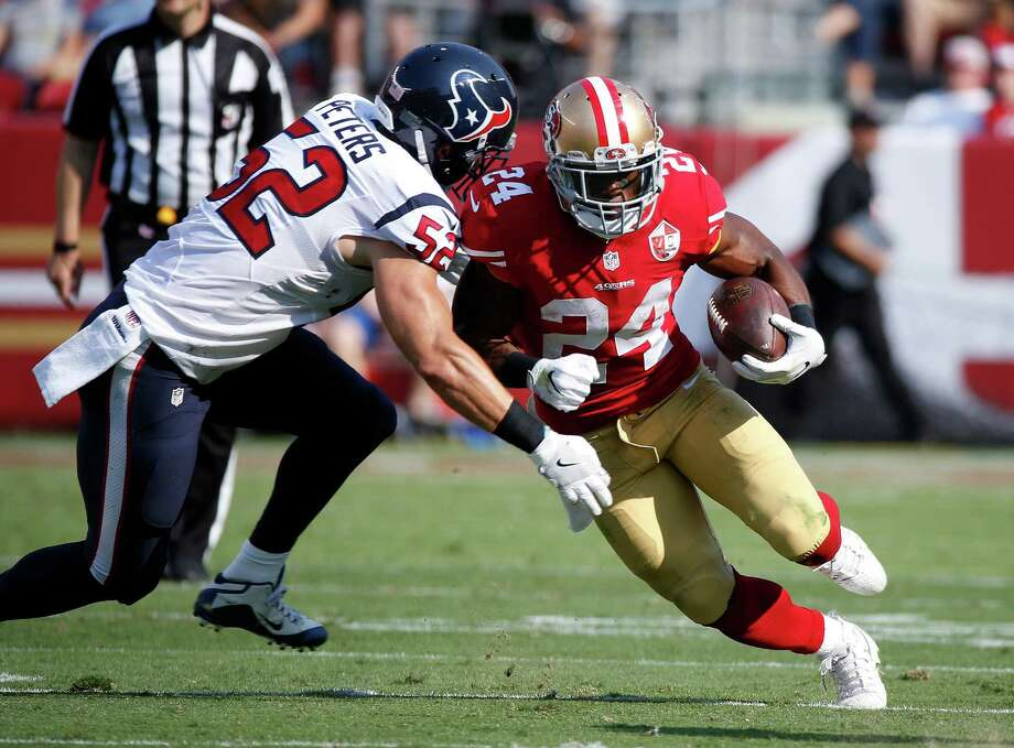 San Francisco 49ers running back Shaun Draughn, right, tries to carry the ball past Houston Texans linebacker Brian Peters during the first half of an NFL preseason football game Sunday, Aug. 14, 2016, in Santa Clara, Calif. (AP Photo/Tony Avelar) Photo: Tony Avelar, Associated Press / FR155217 AP