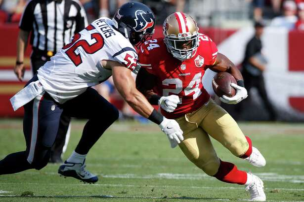 San Francisco 49ers running back Shaun Draughn, right, tries to carry the ball past Houston Texans linebacker Brian Peters during the first half of an NFL preseason football game Sunday, Aug. 14, 2016, in Santa Clara, Calif. (AP Photo/Tony Avelar)
