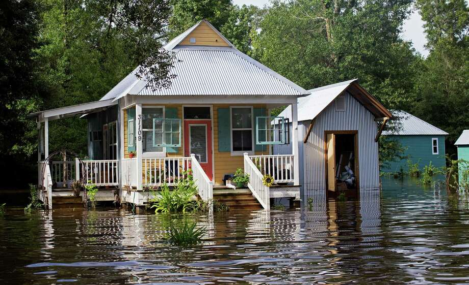 Floodwaters reach the front steps of a home near Holden, La., Sunday, Aug. 14. Photo: Max Becherer, AP Photo / FR 171354AP