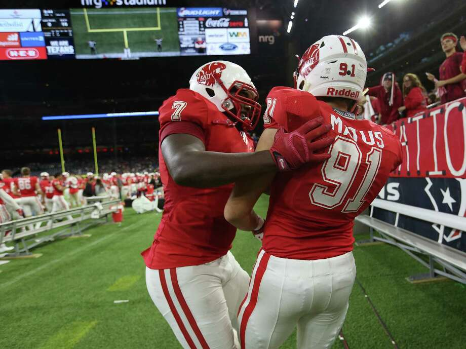 Katy's defense is bolstered by the return of defensive linemen Corey Bethley (left) and Michael Matus (right). Photo: Elizabeth Conley, Staff / © 2015 Houston Chronicle