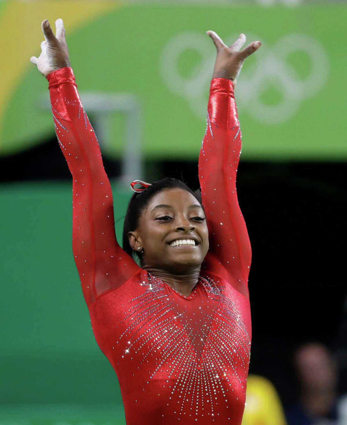 Spring's Simone Biles completes her routine on the vault Sunday to seal the gold. She had never medaled in the vault.