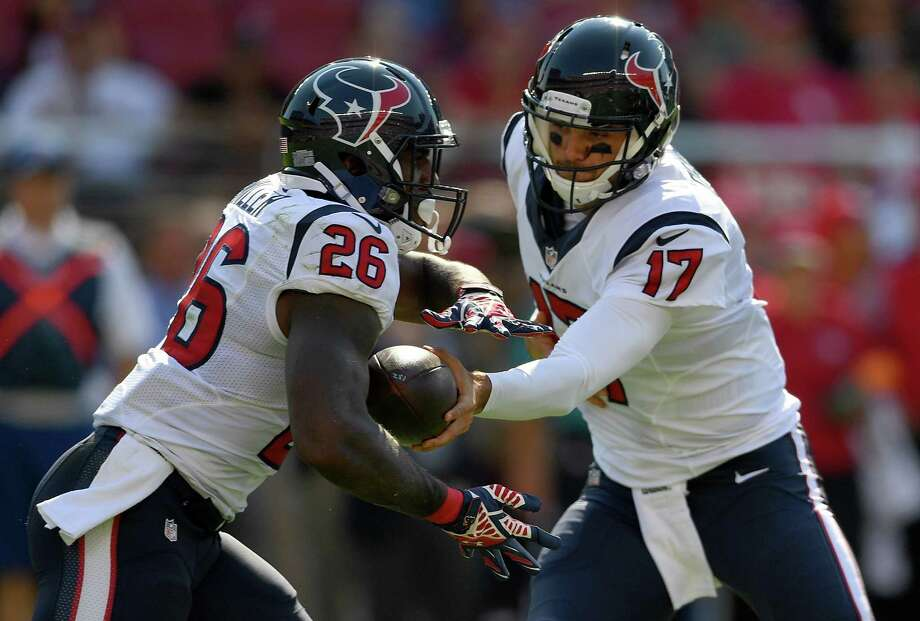 SANTA CLARA, CA - AUGUST 14:  Quarterback Brock Osweiler #17 of the Houston Texans hand the ball off to running back Lamar Miller #26 against the San Francisco 49ers in the first quarter of a preseason game at Levi's Stadium on August 14, 2016 in Santa Clara, California. Photo: Thearon W. Henderson, Getty Images / 2016 Getty Images
