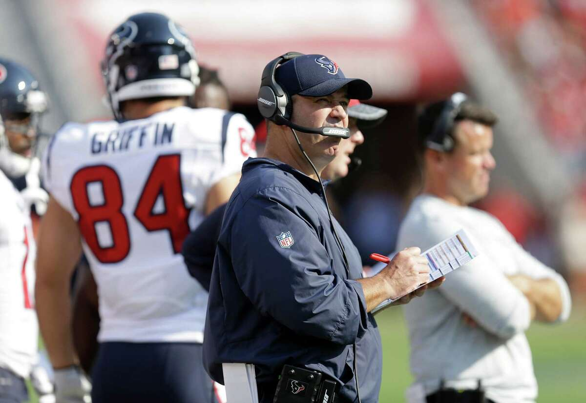 Houston Texans coach Bill O'Brien stands on the sideline during the first half of an NFL preseason football game against the San Francisco 49ers on Sunday, Aug. 14, 2016, in Santa Clara, Calif. At left is Texans tight end Ryan Griffin. (AP Photo/Ben Margot)