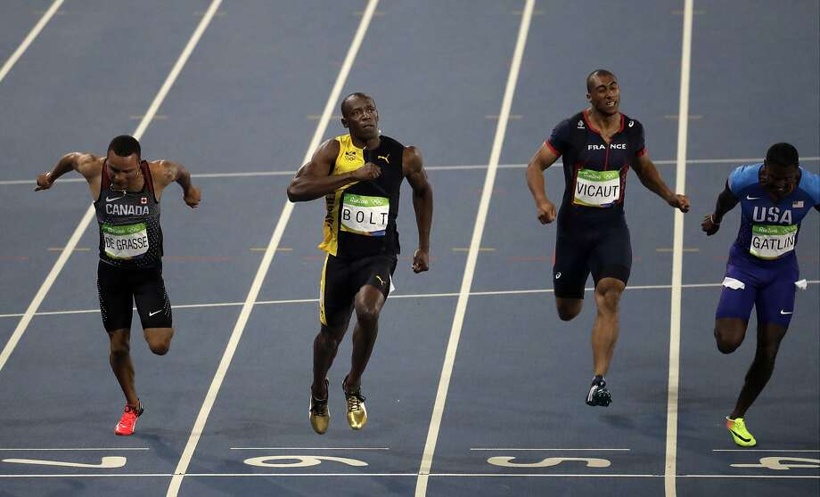 Jamaica's Usain Bolt, second from left, celebrates as he crosses the line to win gold in the men's 100-meter final during the athletics competitions of the 2016 Summer Olympics at the Olympic stadium in Rio de Janeiro, Brazil, Sunday, Aug. 14, 2016. (AP Photo/Julio Cortez) Photo: Julio Cortez, Associated Press