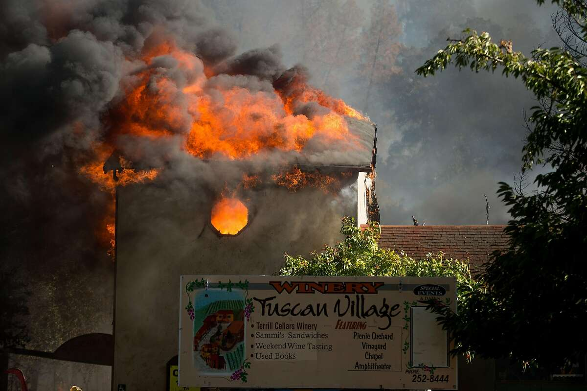 Flames tear through a building at the Tuscan Village/Terrill Cellars Winery as the Clayton Fire burns through downtown Lower Lake, Calif., on Sunday, Aug. 14, 2016.