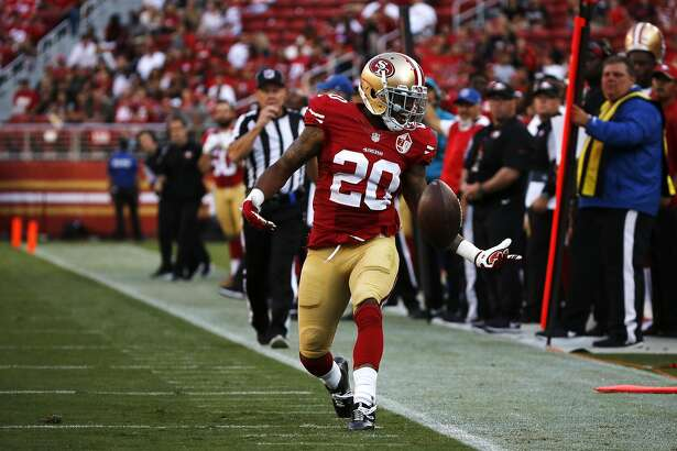 Kenneth Acker (20) reaches for the ball after breaking up a pass but committing a penalty during a preseason game between the 49ers and the Houston Texans at Levi's Stadium in Santa Clara, California, on Sunday, August 14, 2016.
