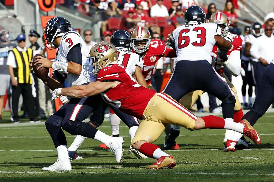 Nick Bellore did well this preseason — here sacking the Texans' Tom Savage — but he's seldom been used on defense in the regular season. Photo: Connor Radnovich, The Chronicle