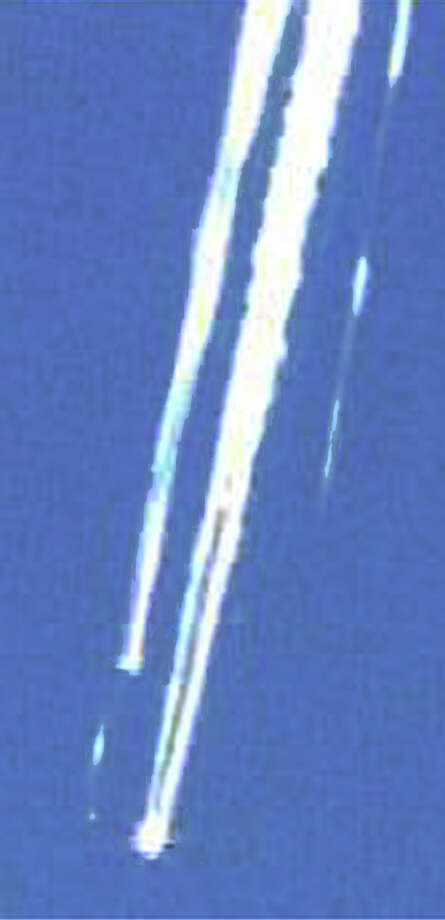 In this image from television, contrails from what appears to be the space shuttle Columbia can be seen streaking across the sky over Texas, Saturday, Feb. 1, 2003. Columbia apparently disintegrated in flames minutes before it was to land in Florida. (AP Photo/via KXAS-TV) Photo: TEL / KXAS-TV