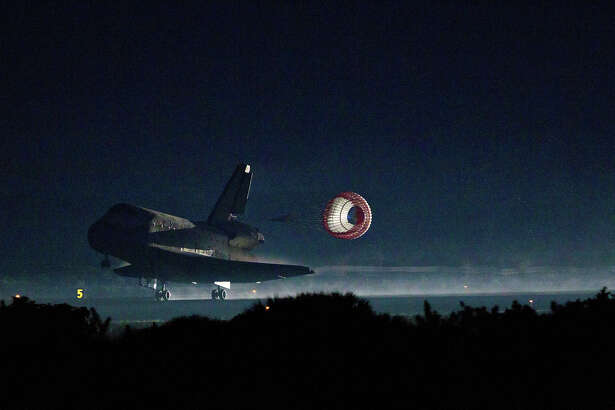 The space shuttle Atlantis lands at the Kennedy Space Center in Florida completing STS-135, the final mission of the NASA shuttle program, on Thursday, July 21, 2011.  ( Smiley N. Pool / Houston Chronicle )