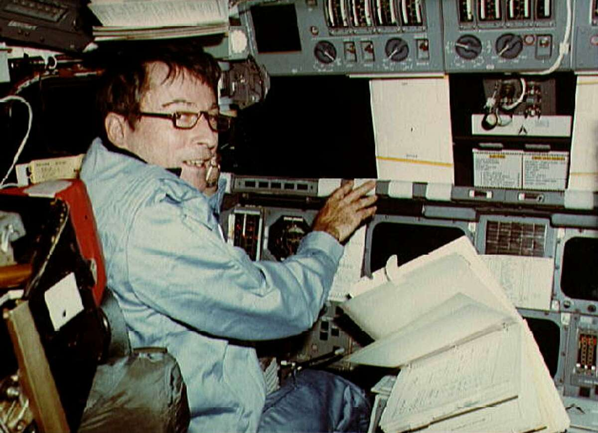 Astronaut John Young mans the commander's station in the Columbia space shuttle during the first shuttle mission in April 1981.