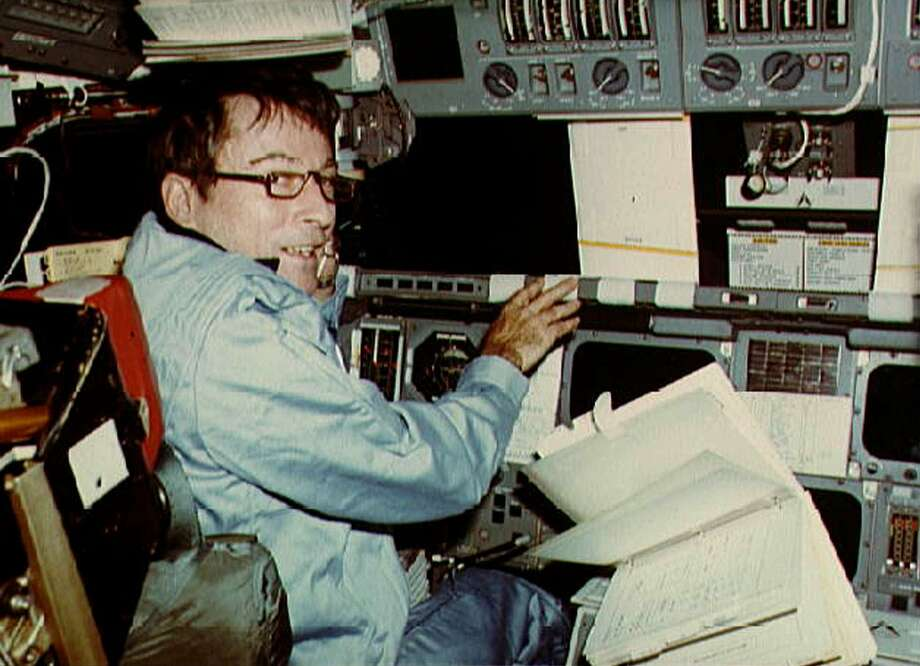 Astronaut John Young mans the commander's station in the Columbia space shuttle during the first shuttle mission in April 1981.  Photo: ROBERT CRIPPEN / NASA