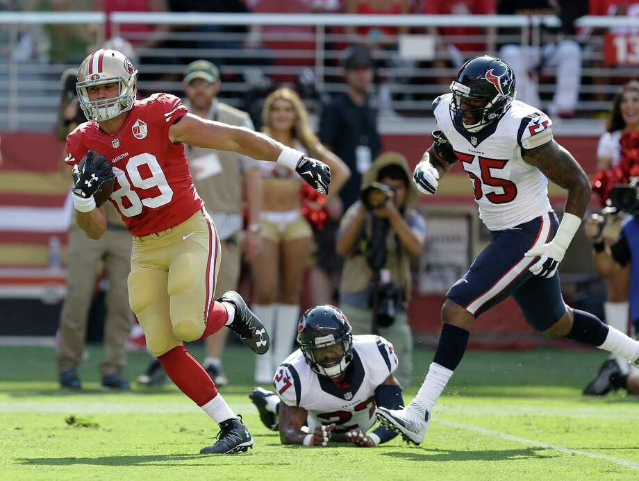 San Francisco 49ers tight end Vance McDonald runs with the ball for a touchdown past Houston Texans strong safety Quintin Demps (27) and inside linebacker Benardrick McKinney (55) during the first half of an NFL preseason football game Sunday, Aug. 14, 2016, in Santa Clara, Calif. (AP Photo/Ben Margot) Photo: Ben Margot, Associated Press / Copyright 2016 The Associated Press. All rights reserved. This material may not be published, broadcast, rewritten or redistribu