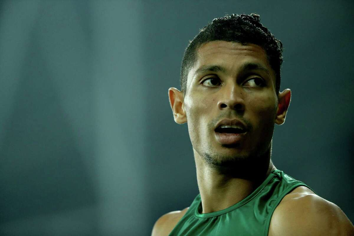 RIO DE JANEIRO, BRAZIL - AUGUST 14: Wayde van Niekerk of South Africa celebrates winning the Men's 400 meter final on Day 9 of the Rio 2016 Olympic Games at the Olympic Stadium on August 14, 2016 in Rio de Janeiro, Brazil. (Photo by Patrick Smith/Getty Images)