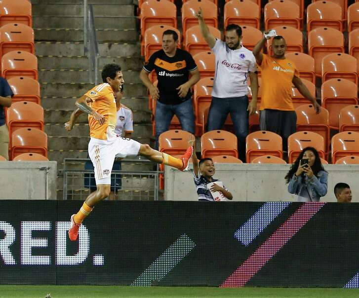 Houston Dynamo midfielder Cristian Maidana (8) celebrates after scoring during the first half against Toronto FC during an MLS soccer match Sunday, Aug. 14, 2016, in Houston. (AP Photo/Bob Levey)