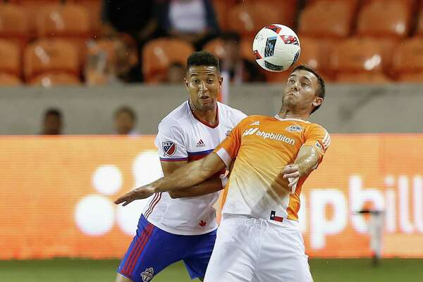 Houston Dynamo forward Andrew Wenger (11) controls the ball in front of Toronto FC defender Justin Morrow during the first half of an MLS soccer match Sunday, Aug. 14, 2016, in Houston. (AP Photo/Bob Levey)