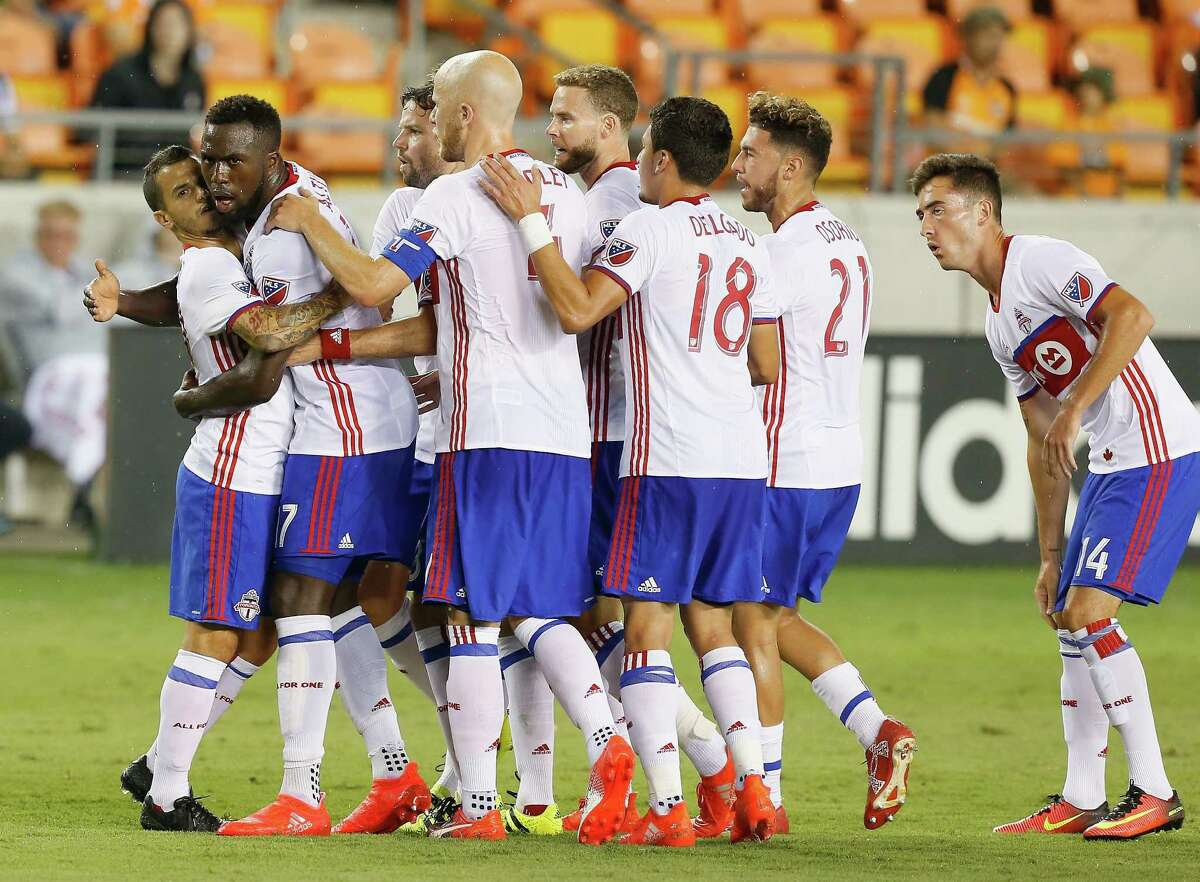 Toronto FC forward Jozy Altidore (17) celebrates with teammates after scoring during the first half against the Houston Dynamo in an MLS soccer match Sunday, Aug. 14, 2016, in Houston. (AP Photo/Bob Levey)