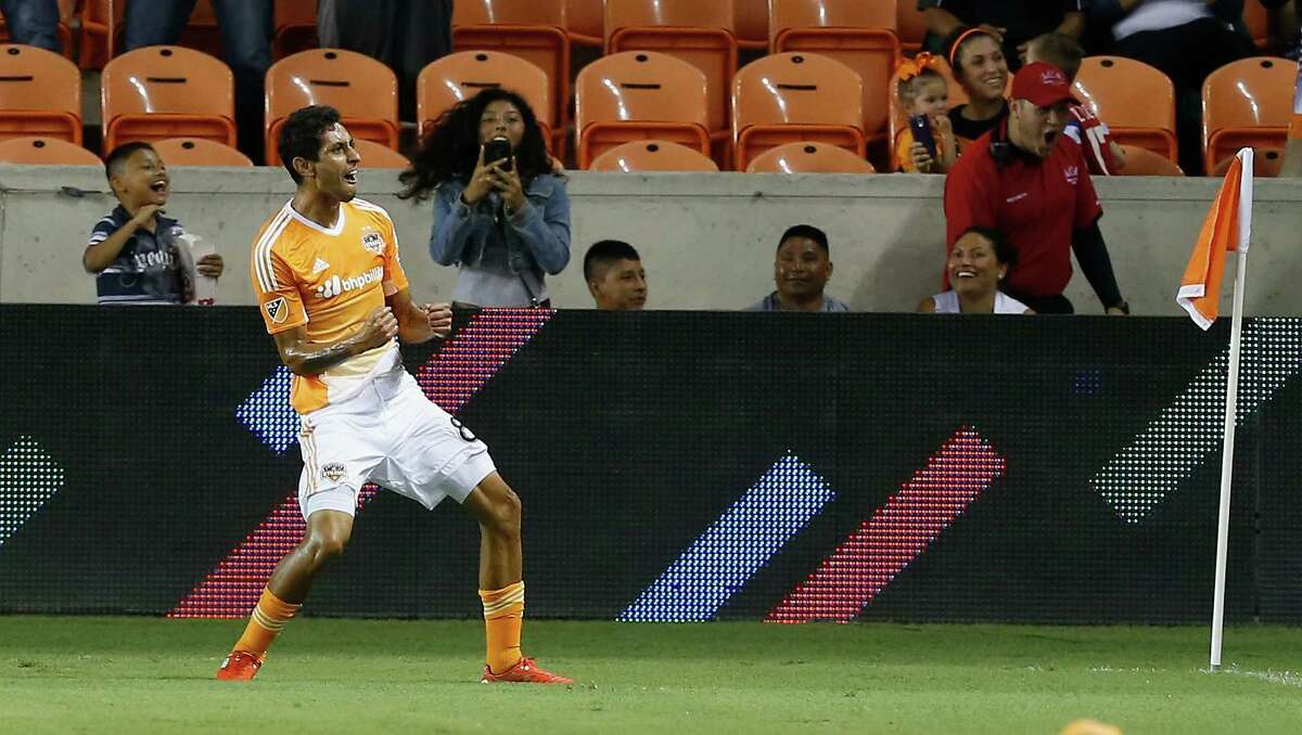 Houston Dynamo midfielder Cristian Maidana celebrates after scoring during the first half against Toronto FC in an MLS soccer match Sunday, Aug. 14, 2016, in Houston. (AP Photo/Bob Levey)