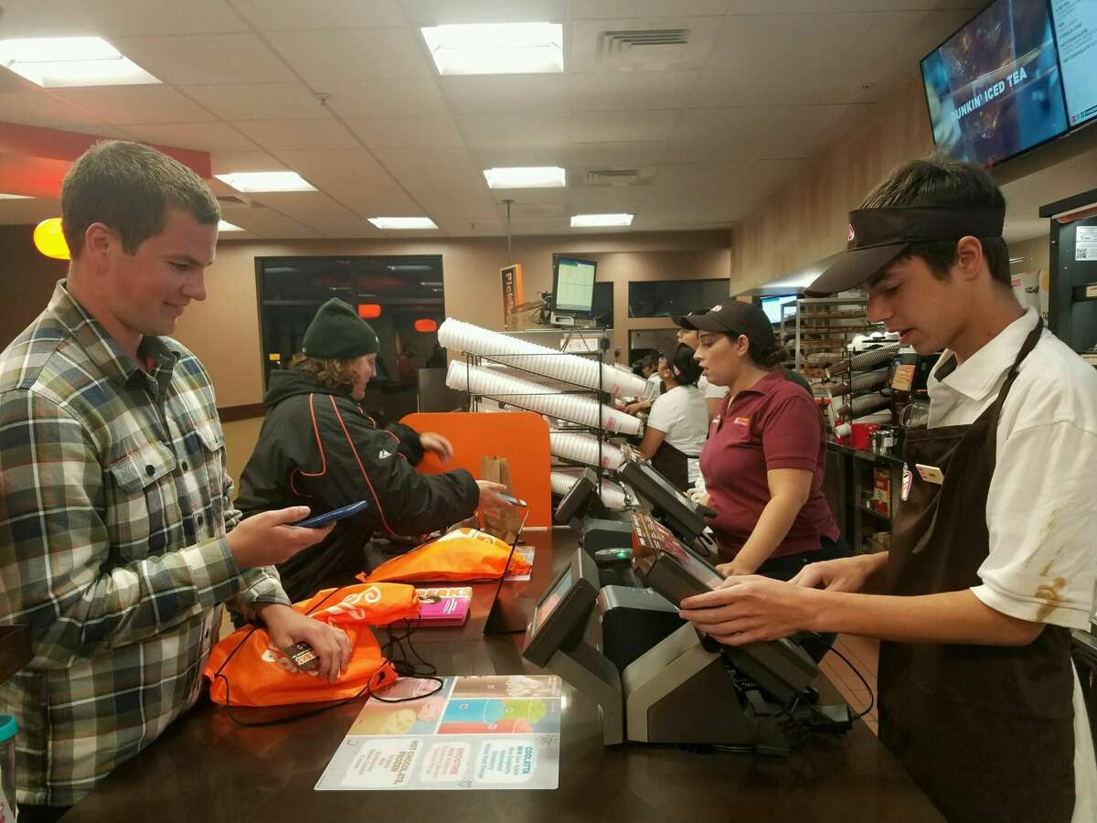 Greg, the first customer at the new Half Moon Bay Dunkin Donuts, ordered four dozen donuts on Aug. 15, 2016.