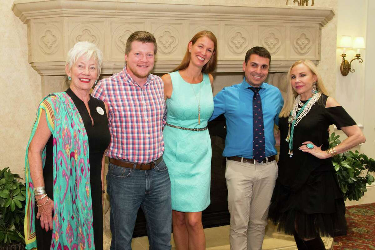 Shown at the event, from left, are Cathy Lightfoot, director of marketing at The Buckingham; Eric Pohl, author of Houston, Texas: A Photogenic Portrait; Hayley Hamilton Cogill, certified sommelier; A.J. Mistretta, author of 100 Things to do in Houston Before You Die; and Carolyn Farb, author of Lucas Comes to America.
