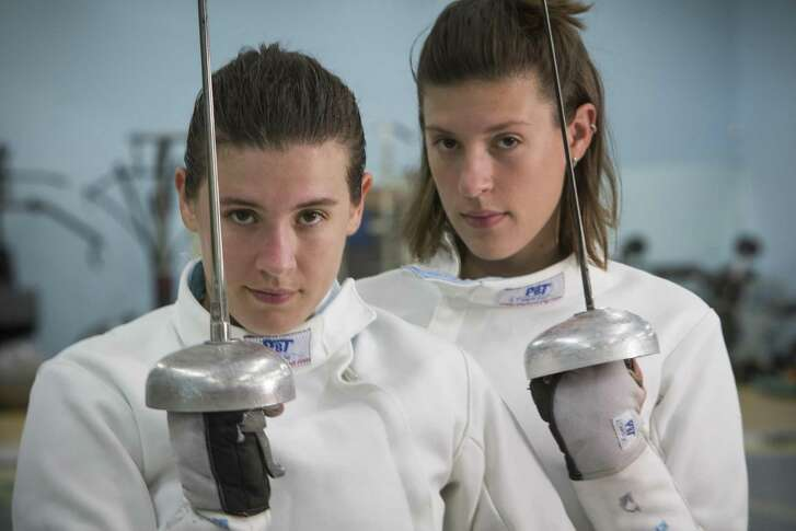 Olympic fencers Courtney Hurley (left) and her sister, Kelley, pose for a portrait at Alliance Fencing Academy while preparing for the Rio Olympics on July 14, 2016, in Houston.