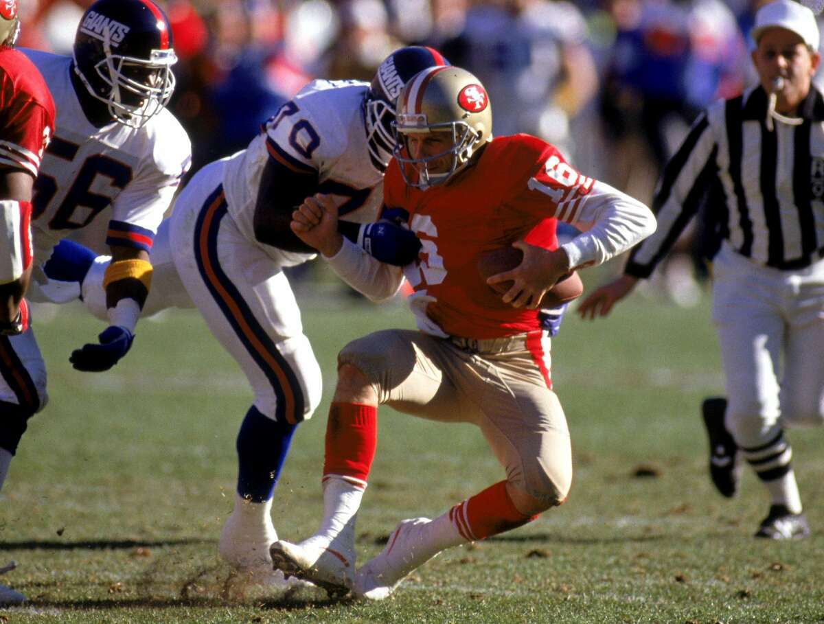 SAN FRANCISCO - JANUARY 20: Joe Montana #16 the San Francisco 49ers gets sacked by New York Giants defensive tackle Leonard Marshall #70 during the 1990 NFC Championship game at Candlestick Park on January 20, 1991 in San Francisco, California. The Giants won 15-13. (Photo by George Rose/Getty Images)