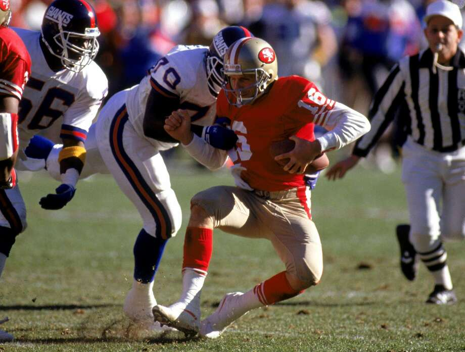 Joe Montana (right) gets sacked in the NFC Championship game. Photo: George Rose, Getty Images