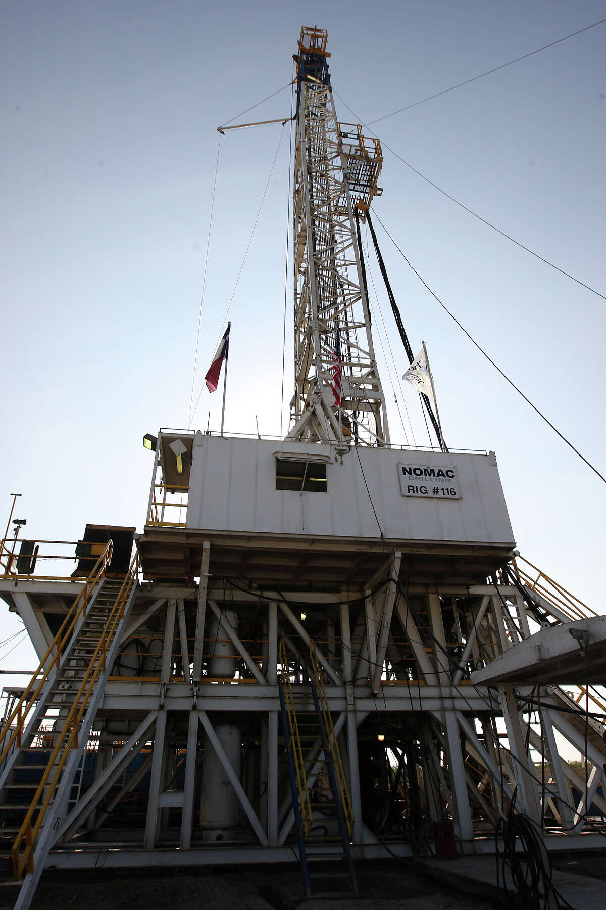 File photo of a Chesapeake Energy well by Carriso Springs. The company is seeking a $1 billion loan as the company battered by cratering fuel prices and credit downgrades takes a step to address its $9 billion debt load.
