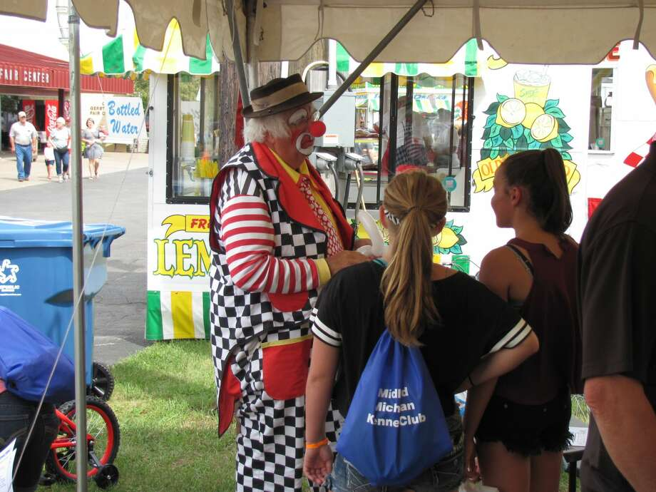 Scenes from the Daily News fair booth and around the Midland County Fair Monday. Photo: Midland Daily News