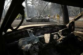 After the Clayton fire roared through on Sunday, CalFire puts out hot spots along Main Street in Lower Lake, Calif., on Monday, August 15, 2016.