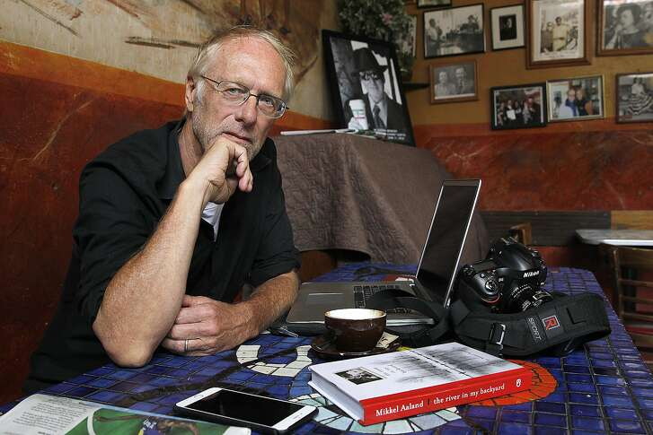 Photographer and writer Mikkel Aaland at Cafe at Trieste where he spent much of his time working on his latest book on Thursday, August 11, 2016, in San Francisco, Calif.  Aaland has just written a memoir about his younger brother killing their father at home in Livermore.