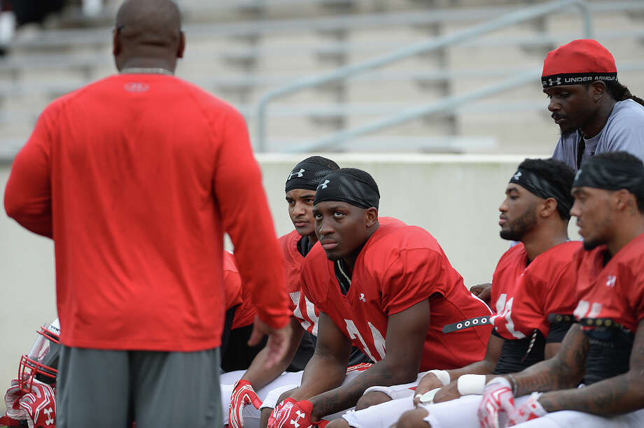 Lamar's defense listen to coaching advice in-between plays as the offense and defense grapple on field during their first fall season scrimmage Saturday. Photo taken Saturday, August 13, 2016 Kim Brent/The Enterprise Photo: Kim Brent / Beaumont Enterprise