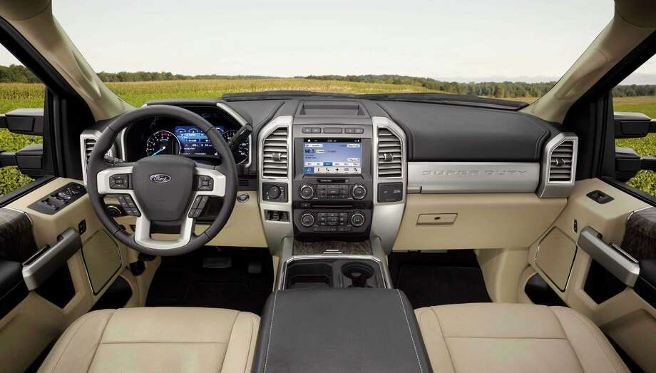 The Super Duty's new instrument panel put controls in easier reach with the 4x4 selector and integrated trailer brake controller mounted higher and oriented toward the driver. Photo: Ford