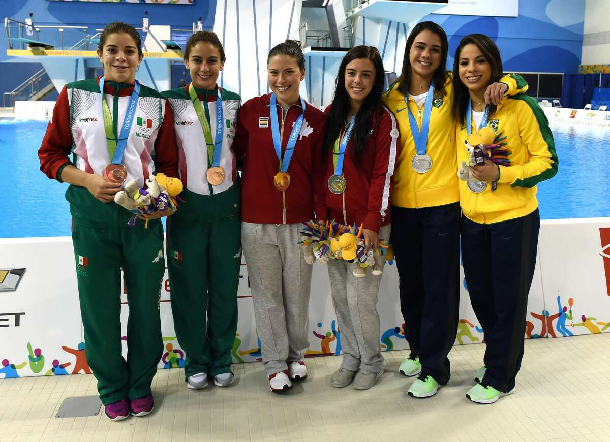 Happier times: Giovanna Perdroso and Ingrid Oliveira of Brazil (far right) pose after the Women's Synchonised 10m Platform Finals in 2015.