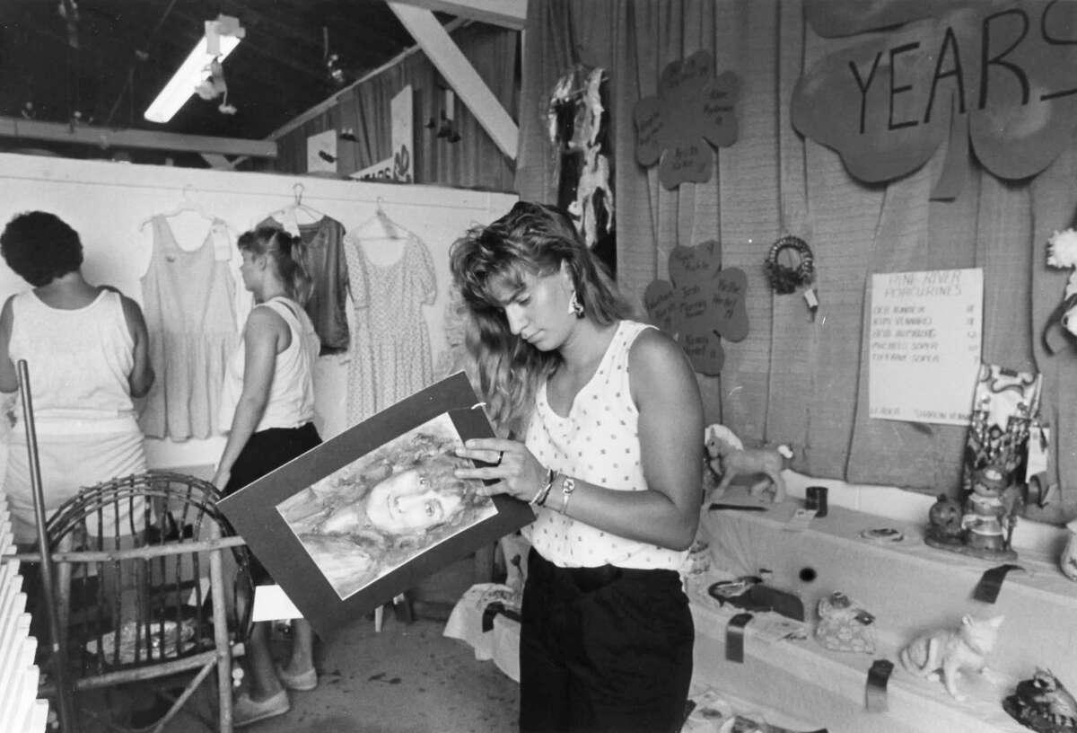 Deb Adamcik prepares a piece of art for haning in a 4-H exhibit. August 1989