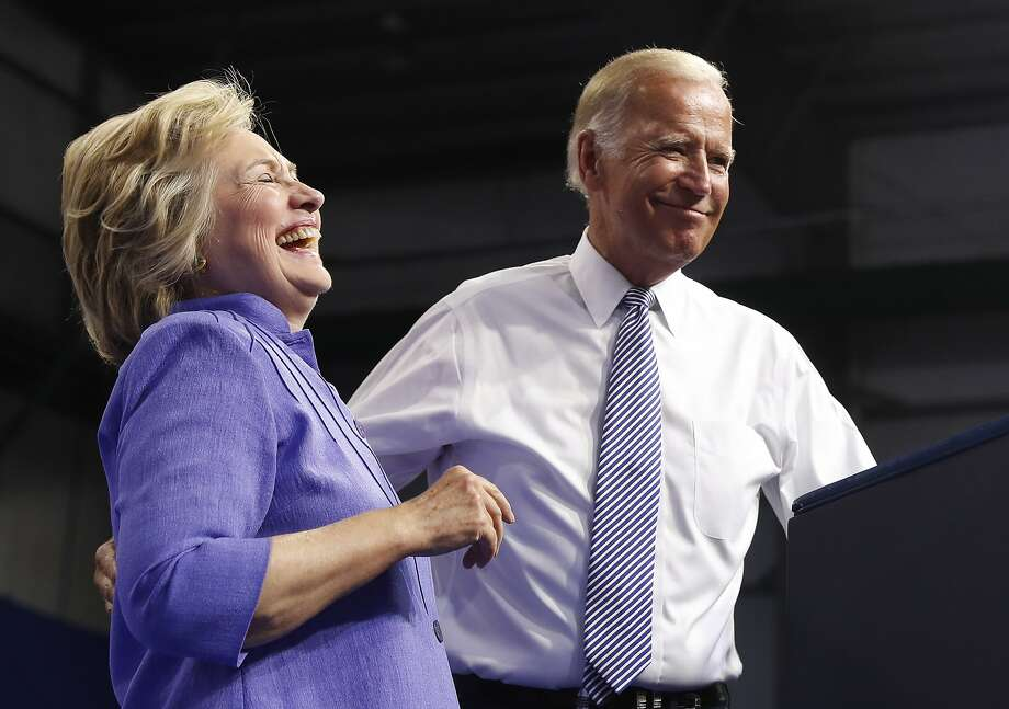 Democratic presidential candidate Hillary Clinton and Vice President Joe Biden stand together on stage during a campaign event at Riverfront Sports in Scranton, Pa., Monday, Aug. 15, 2016. (AP Photo/Carolyn Kaster) Photo: Carolyn Kaster, Associated Press