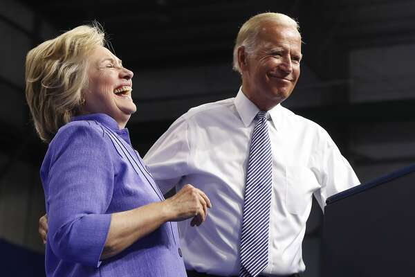 Democratic presidential candidate Hillary Clinton and Vice President Joe Biden stand together on stage during a campaign event at Riverfront Sports in Scranton, Pa., Monday, Aug. 15, 2016. (AP Photo/Carolyn Kaster)