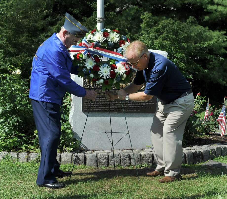 John Edmond, left, 90, of Danbury, who served on the U.S. Providence during World War II and Mayor Mark Boughton,  place a wreath at the War War II monument Monday morning. A ceremony at the Rogers Park Rose Garden marked the 71 st anniversary of the Japanese surrender and the end of World War II,  Monday, August 15, 2016 in Danbury. Photo: Carol Kaliff / The News-Times