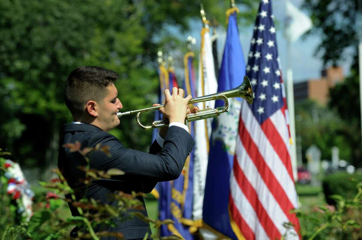 Max Durkin plays Taps during monday morning's ceremony to mark the 71 st anniversary of the Japanese surrender and the end of World War II, Monday, August 15, 2016 in Danbury at the Rogers Park Rose Garden.